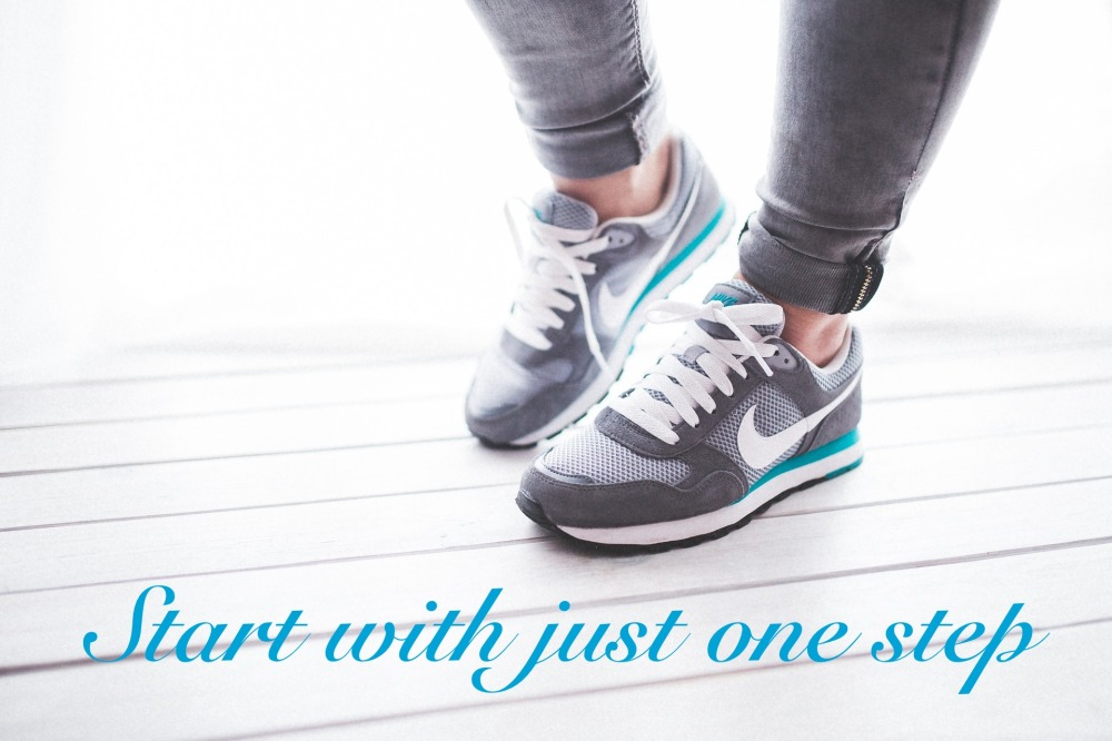"Ankles and feet in tennis shoes grey/white/teal with text ""Start with just one step"""