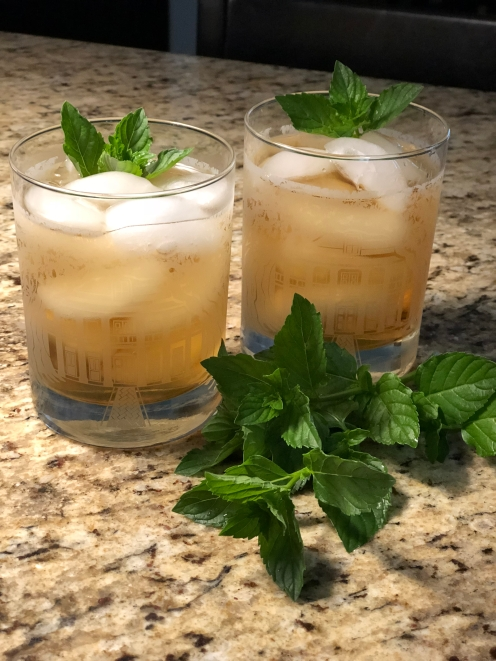 Chilled mint tea in two ice cube filled glasses with sprigs of mint as garnish