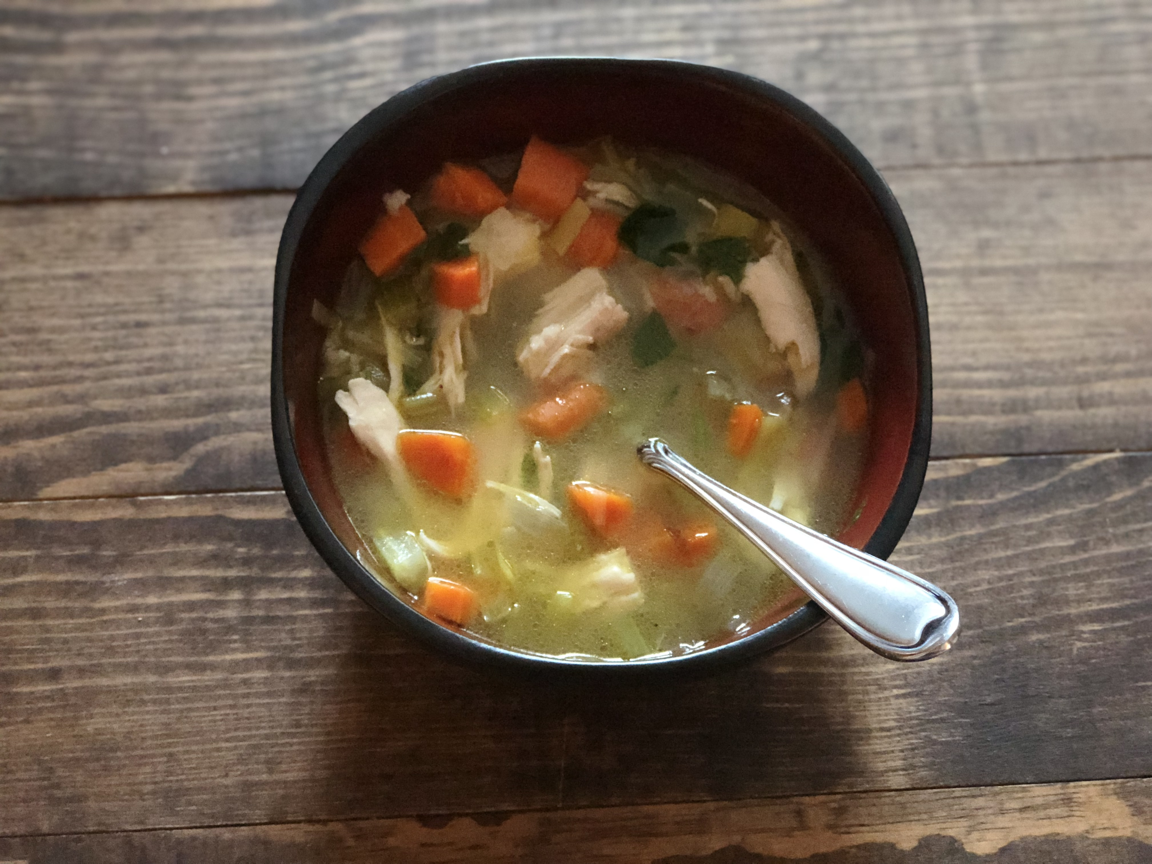 Chicken soup in bowl